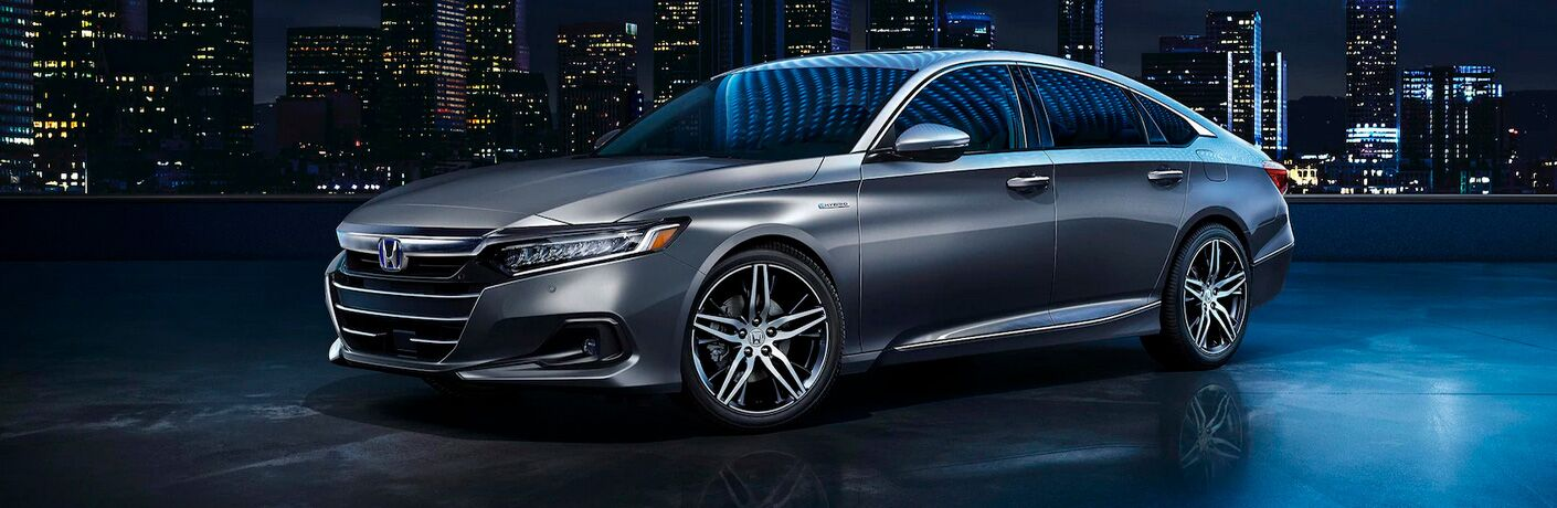 Gray 2021 Honda Accord Hybrid with Nighttime City Skyline in the Background
