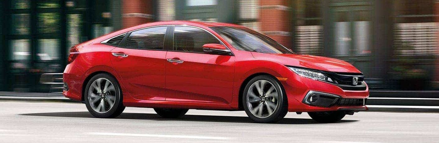The 2021 Honda Civic Coupe in red on road