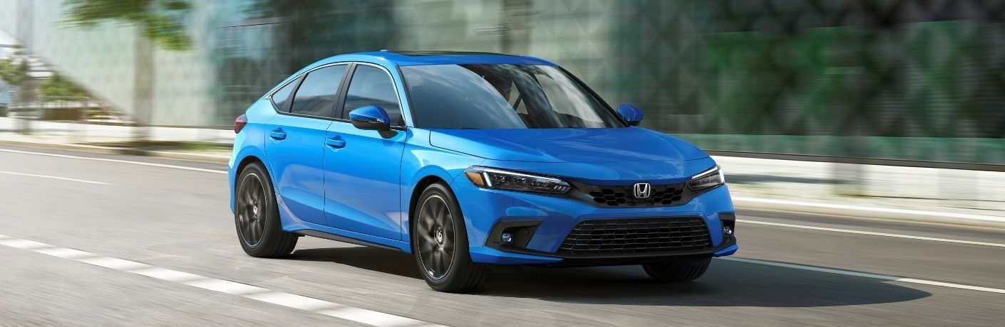 Blue 2022 Honda Civic Hatchback Front Exterior on a Freeway