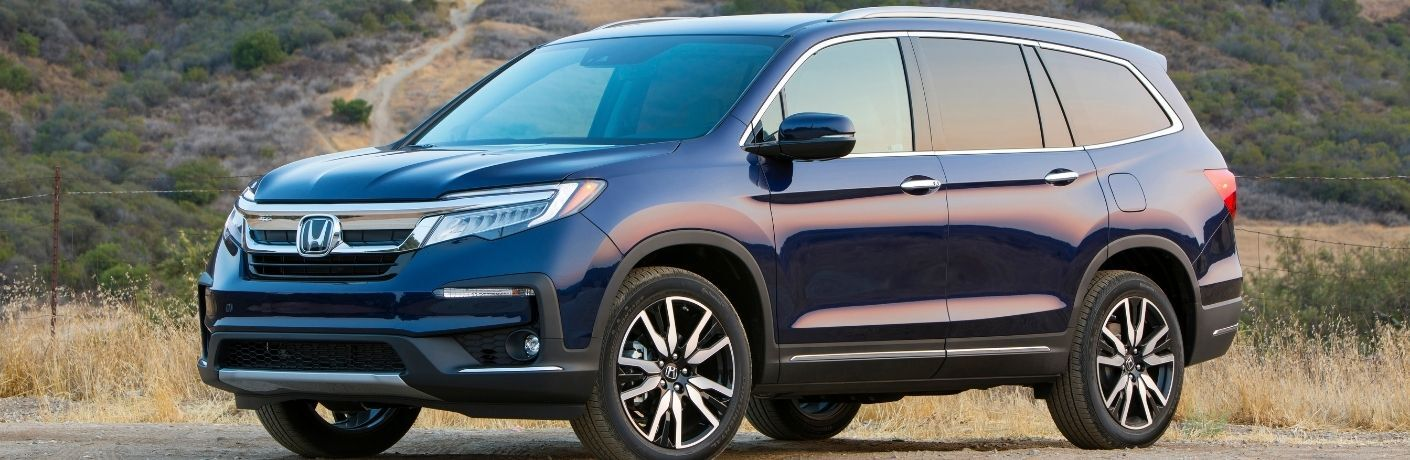 Blue 2022 Honda Pilot Front Exterior on a Country Road