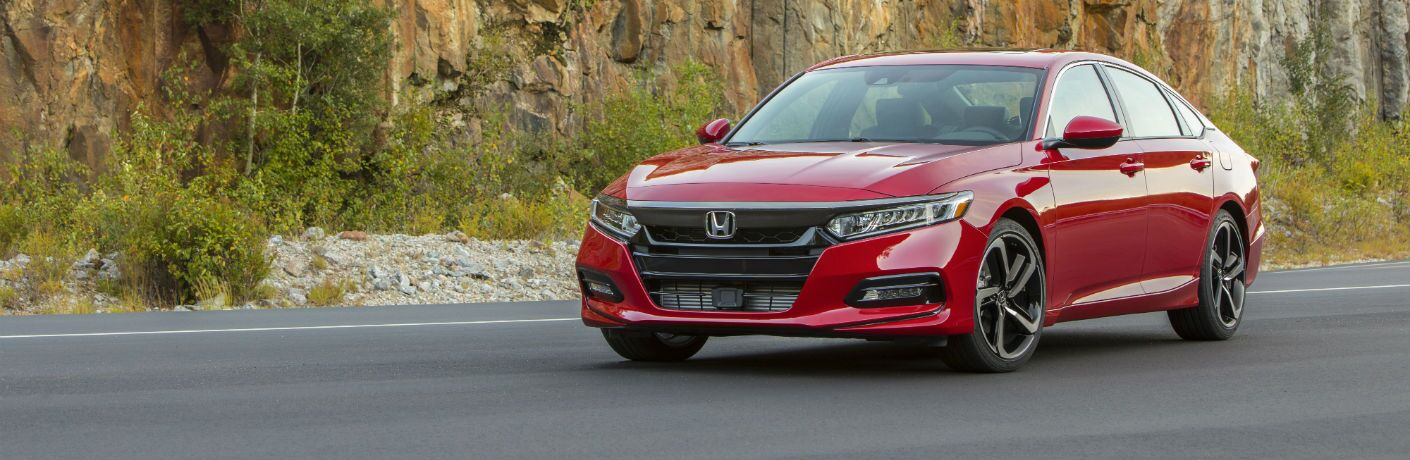 A front left quarter photo of the 2019 Honda Accord parked on the road.