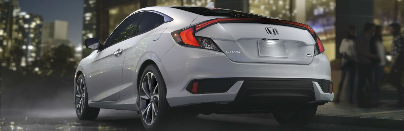 A rear left quarter photo of the 2019 Honda Civic Coupe.