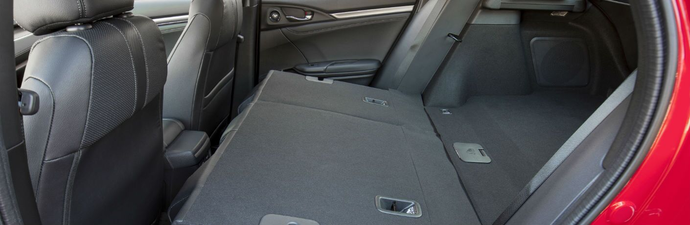 A photo of the back seats of the 2019 Honda Civic Hatchback folded down.