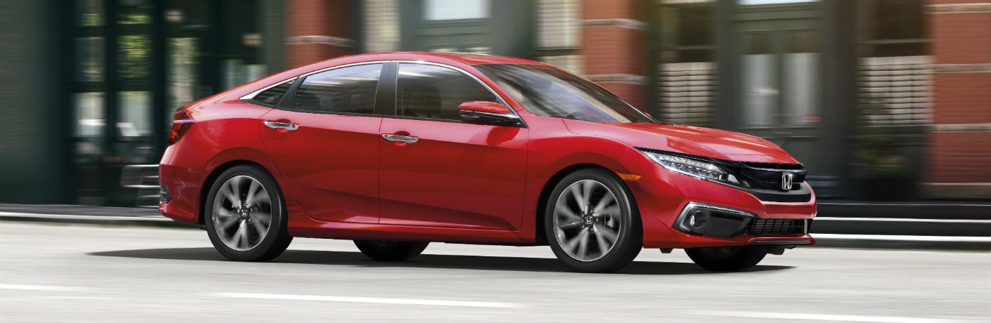 A right profile photo of the 2019 Honda Civic Sedan on the road.