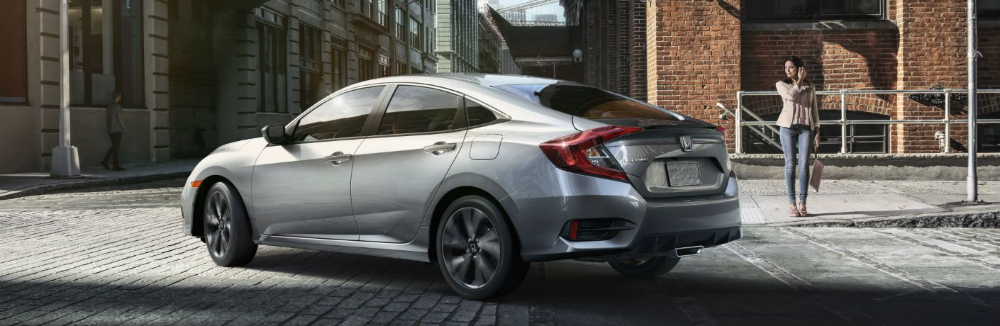 A left rear quarter photo of the 2019 Honda Civic Sedan parked on the street.