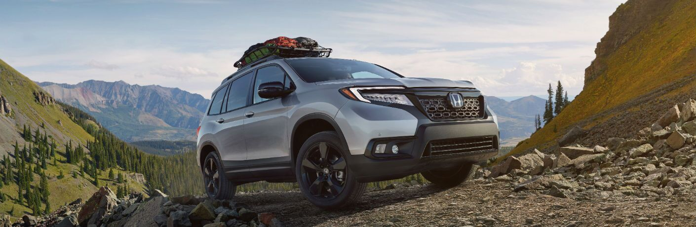 A front right quarter photo of the 2019 Honda Passport parked on a rocky trail.