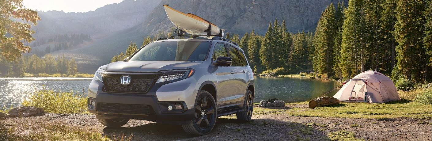 A front left quarter photo of the 2019 Honda Passport parked by a lake.