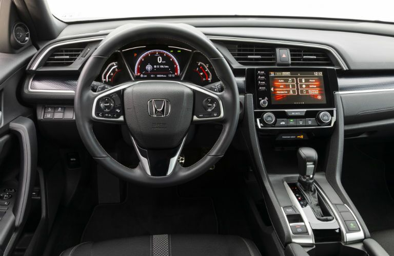 A photo of the driver's cockpit in the 2019 Honda Civic Coupe.