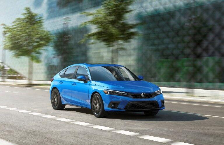 The 2022 Honda Civic Hatchback on a city road.