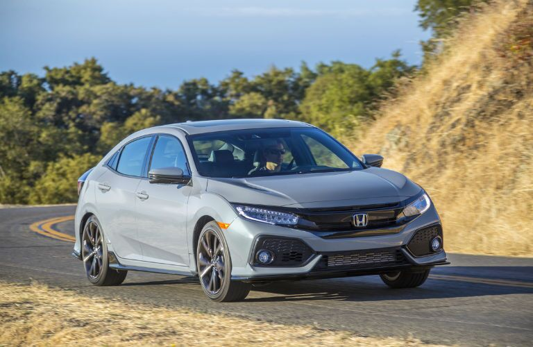 A front right quarter photo of the 2019 Honda Civic Hatchback.