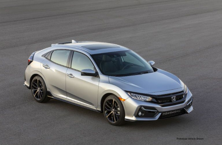 A photo of the 2021 Honda Civic Hatchback in a parking lot.