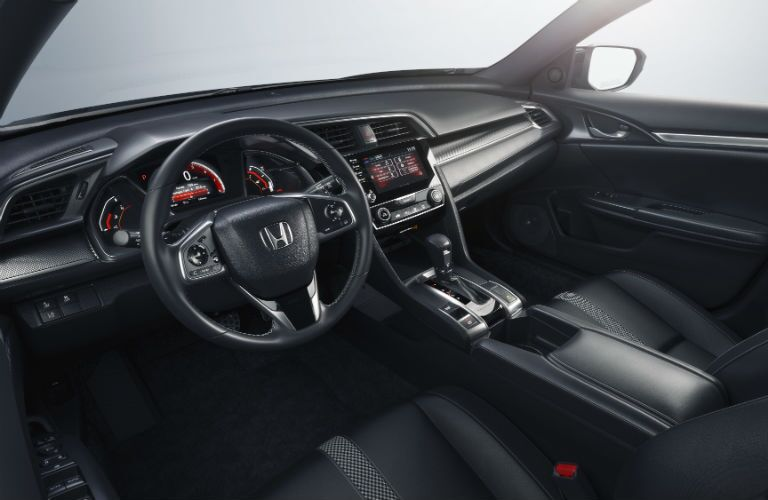 A photo of the front seats in the 2019 Honda Civic Sedan.