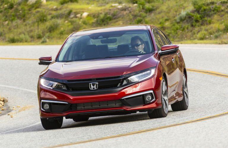 A head-on photo of the 2021 Honda Civic Sedan on the road.