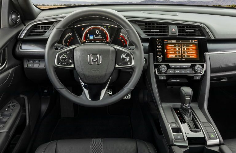 A photo of the driver's cockpit in the 2020 Honda Civic Hatchback.