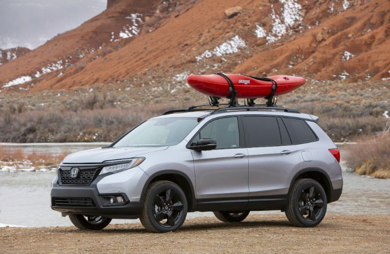 A photo of the 2019 Passport with a kayak on the roof.