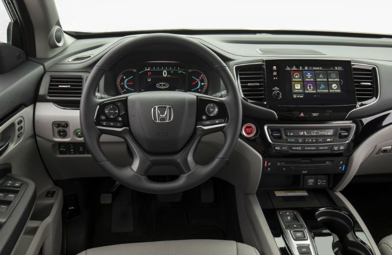 A photo of the driver's cockpit in the 2021 Honda Pilot.