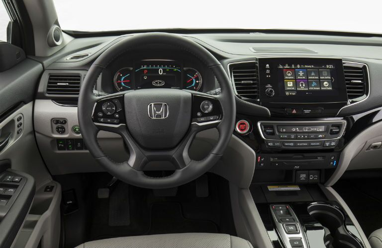 An interior photo of the driver's cockpit in the 2020 Honda Pilot.