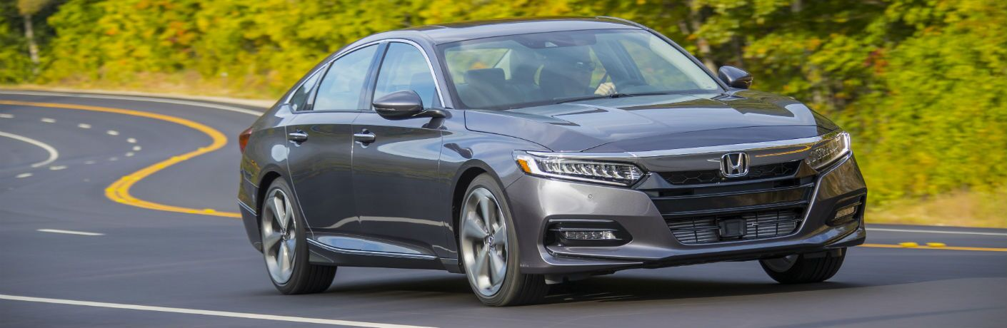 A front right quarter photo of a 2020 Honda Accord on the road.