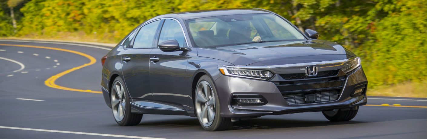 A front right quarter photo of the 2020 Honda Accord on the road.