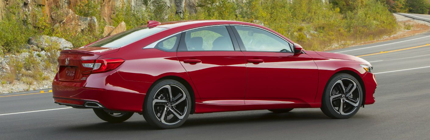 A right profile photo of the 2020 Honda Accord parked on a road.