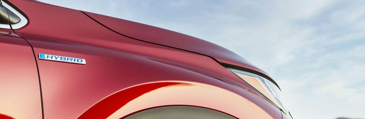A photo of the hybrid badge used by the 2020 Honda CR-V Hybrid.