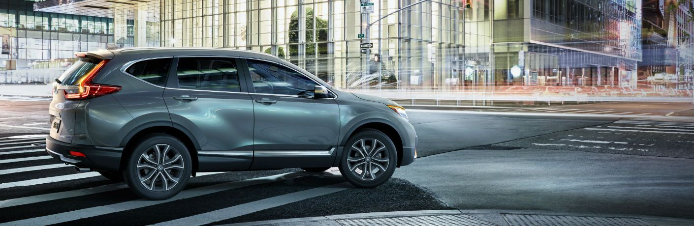 A right profile photo of the 2020 Honda CR-V on the road.