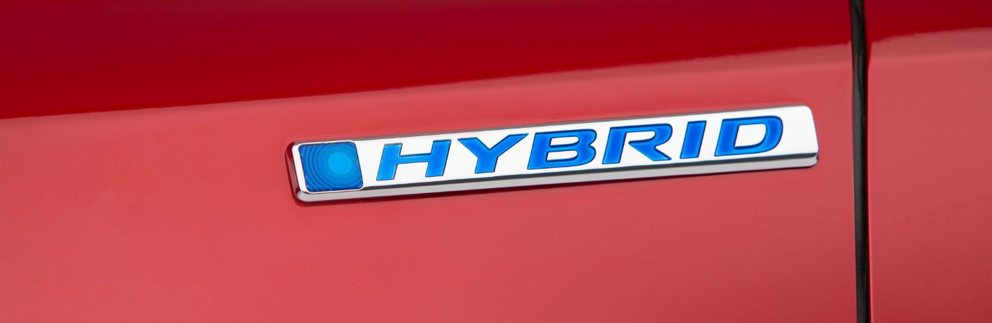 A photo of the hybrid badge worn by the 2020 Honda CR-V Hybrid.
