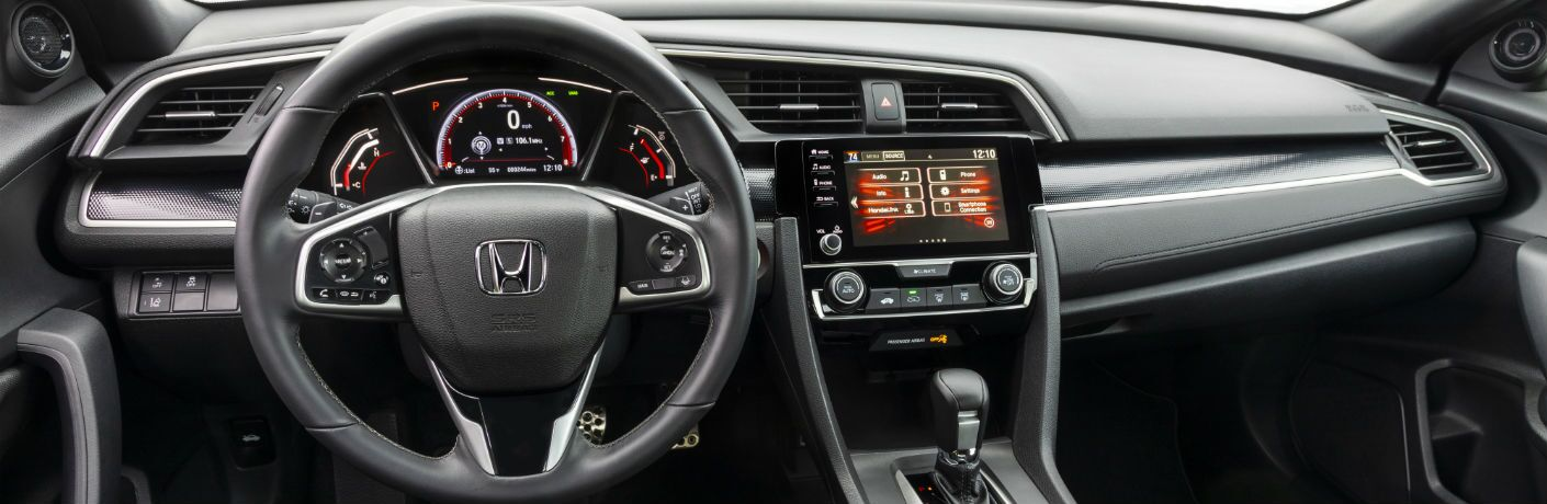 A photo of the dashboard in the 2020 Honda Civic Coupe.