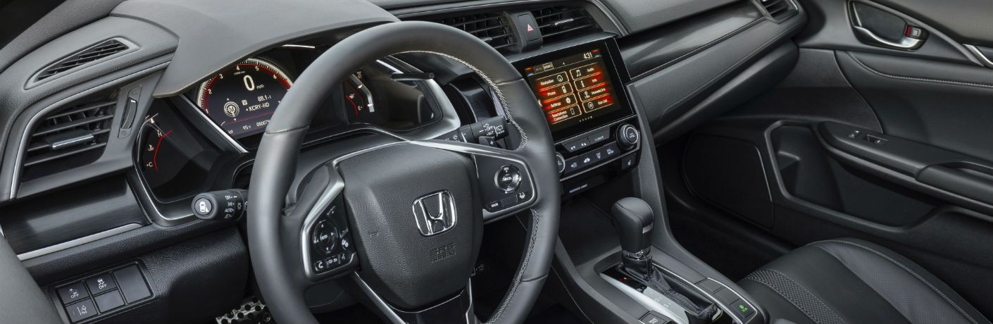 A photo of the dashboard in the 2020 Honda Civic Hatchback.