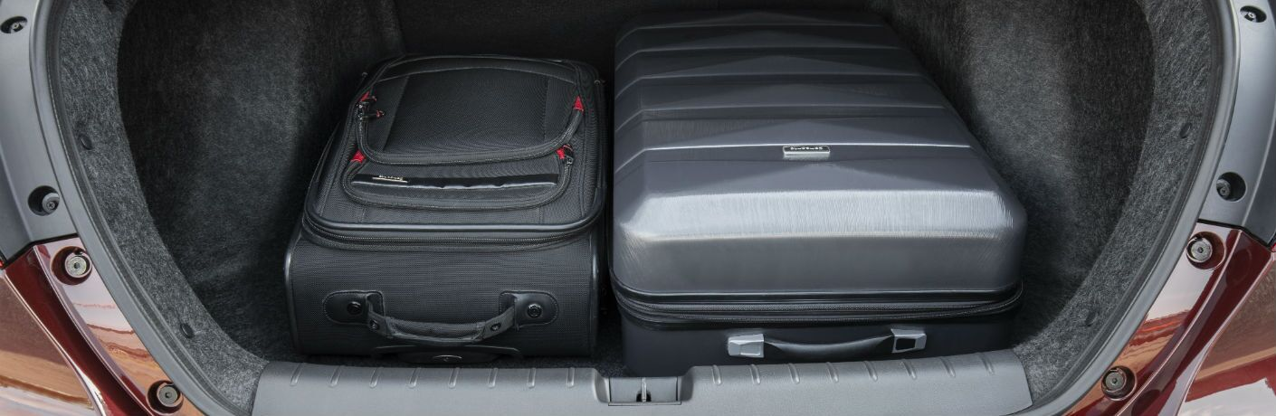 A photo of large suitcases in the trunk of the 2020 Honda Insight.