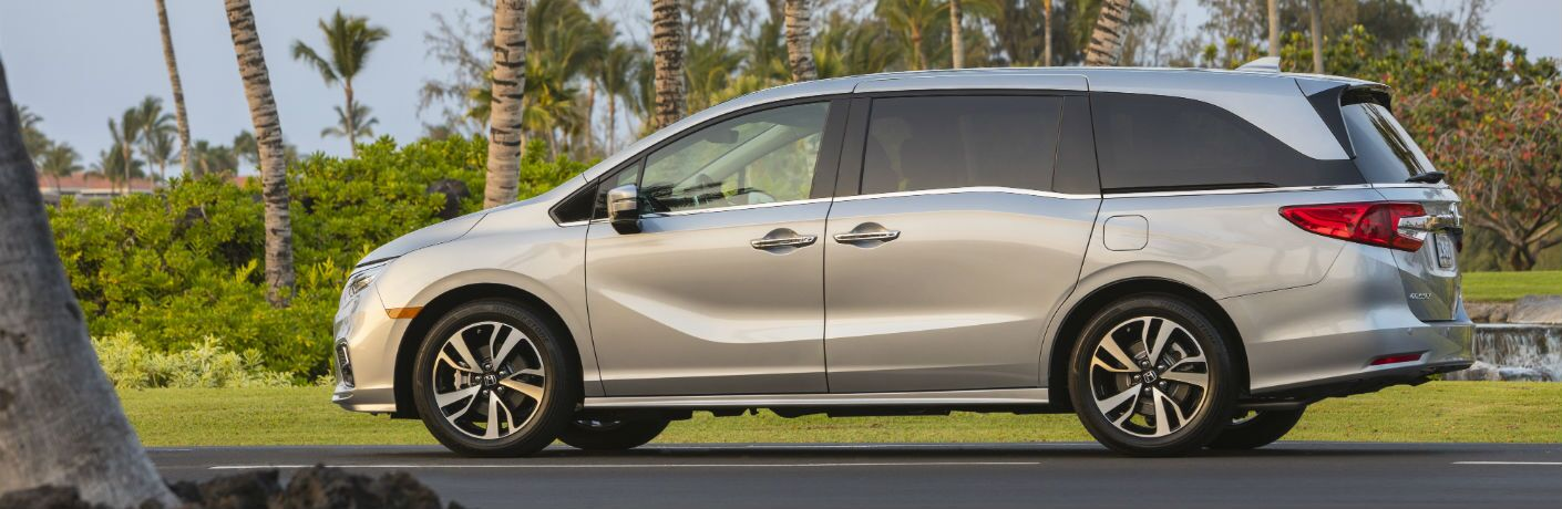 A left profile photo of the 2020 Honda Odyssey parked on the road.