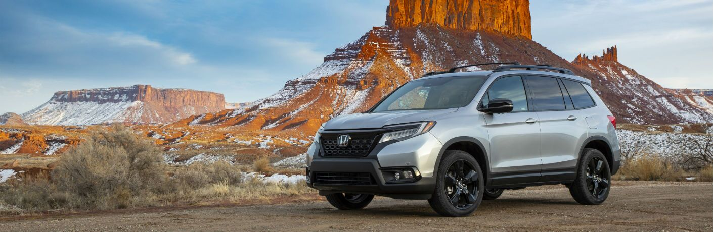 A front left quarter photo of the 2020 Honda Passport parked in the desert.
