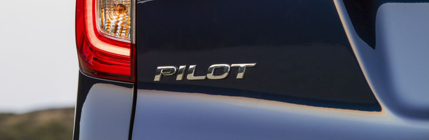 A photo of the Pilot badge on the back of the 2020 Honda Pilot.