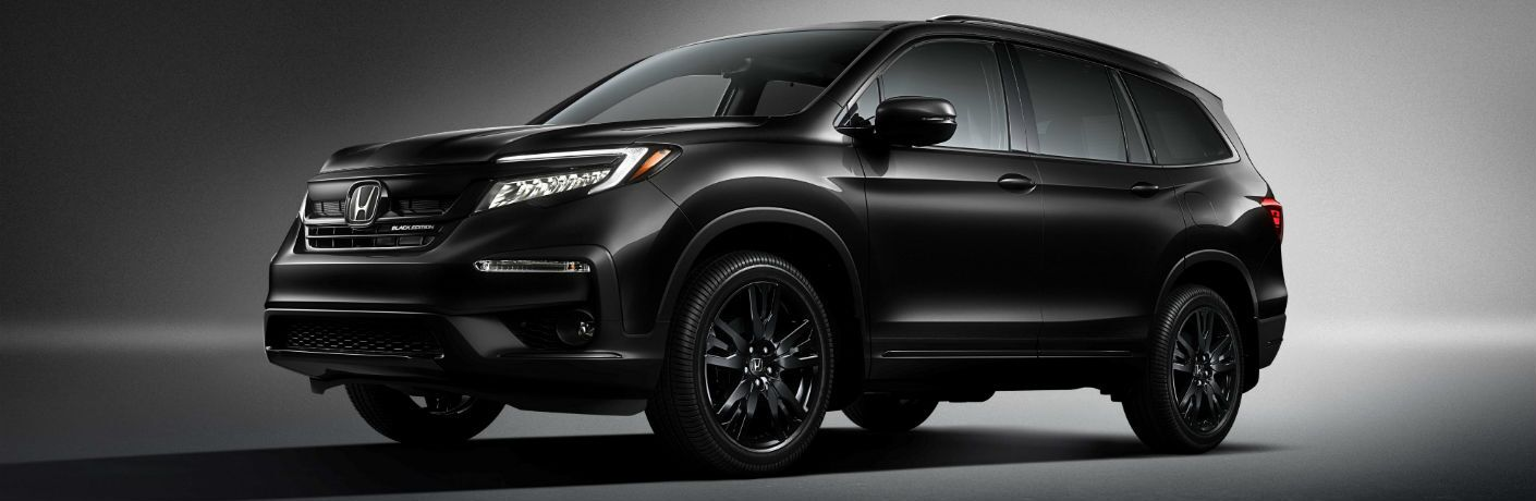 A photo of the 2020 Honda Pilot Black Edition in a studio.