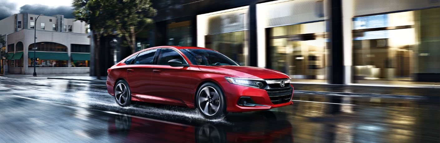 A right profile photo of the 2021 Honda Accord on the road.