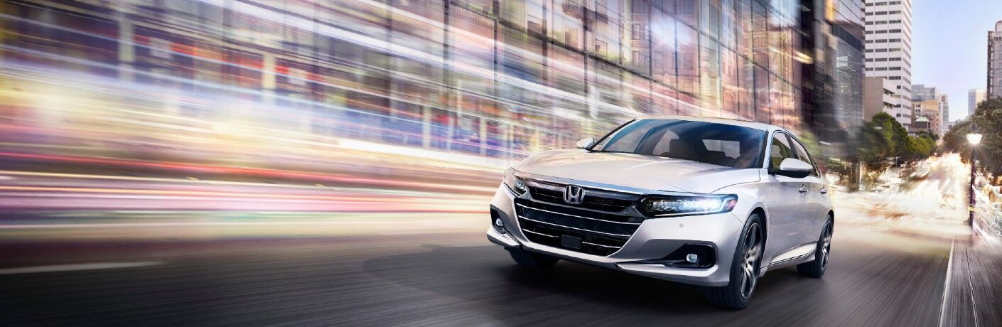 A head-on photo of the 2021 Honda Accord on the road.