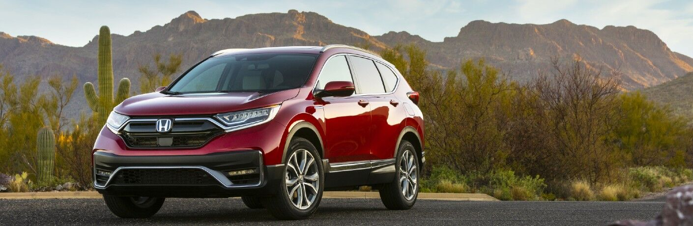 A front left quarter photo of the 2021 Honda CR-V Hybrid parked on the road.