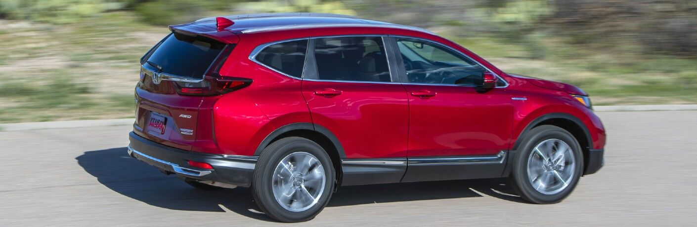 A right profile photo of the 2021 Honda CR-V Hybrid in motion on the road.