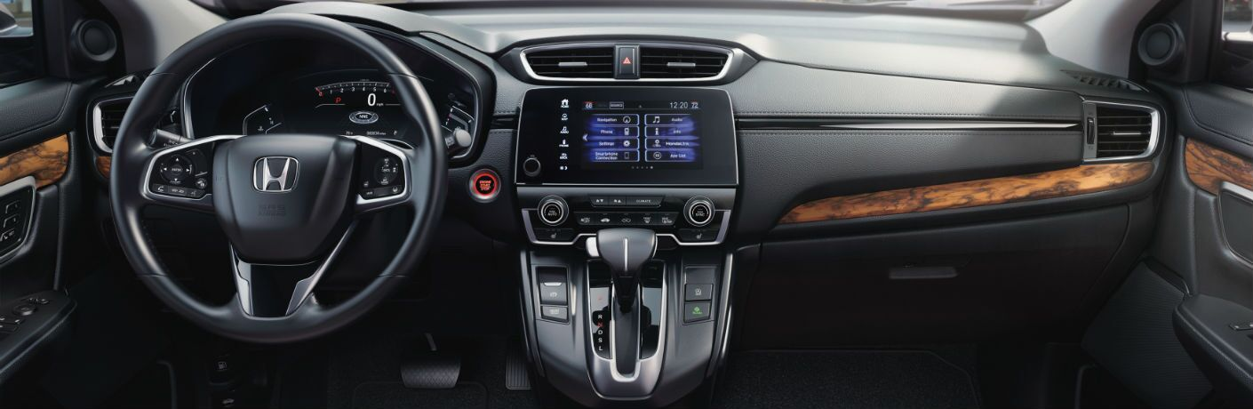 A photo of the driver's cockpit and dashboard in the 2021 Honda CR-V.