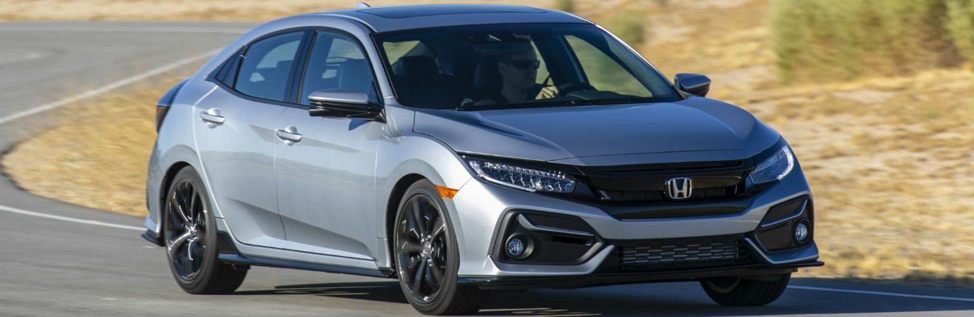 A front right quarter photo of the 2021 Honda Civic Hatchback on the road.