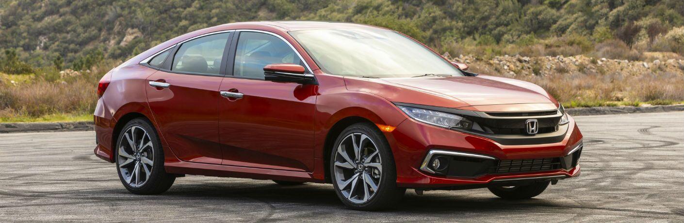 A front right quarter photo of the 2021 Honda Civic Sedan.
