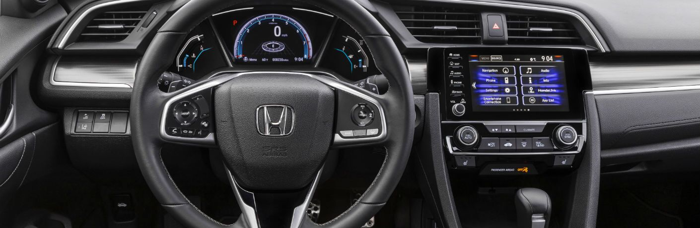 A photo of the driver's cockpit and dashboard in the 2021 Honda Civic Sedan.