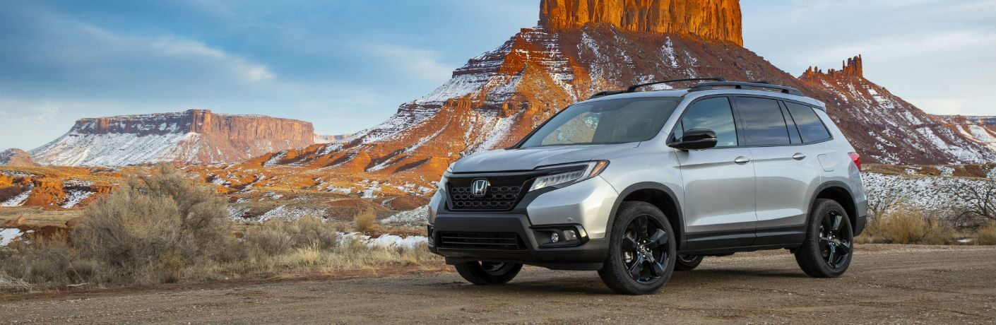 A left profile photo of the 2021 Honda Passport parked in the desert.
