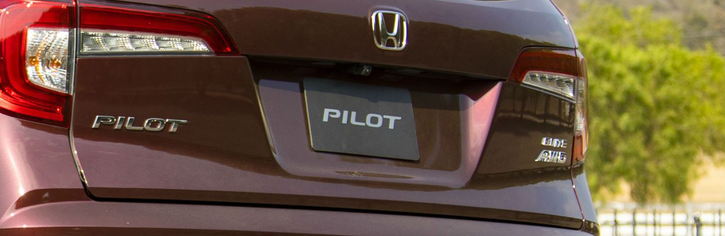 A photo of the badges available on the back of the 2021 Honda Pilot.