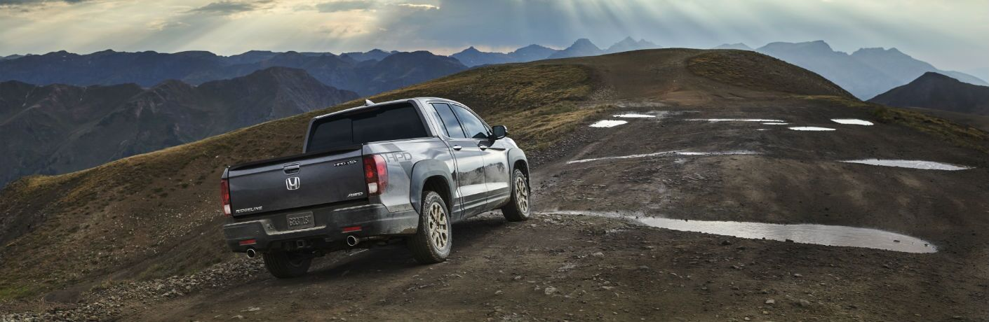 A rear photo of the 2021 Honda Ridgeline climbing a hill.