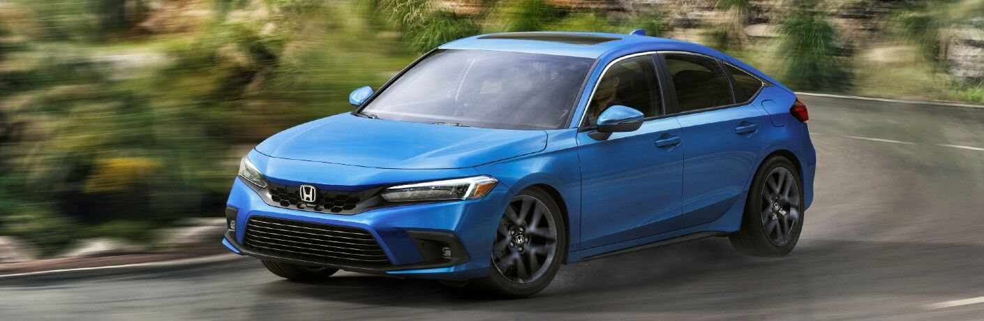 The 2022 Honda Civic Hatchback on a mountain road.