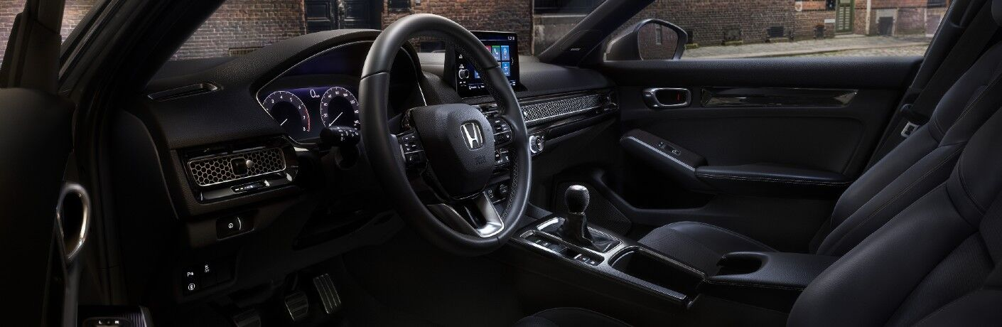 The driver's cockpit in the 2022 Honda Civic Hatchback.