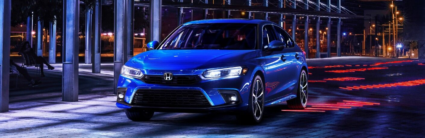 A head-on look at the 2022 Honda Civic on a street.