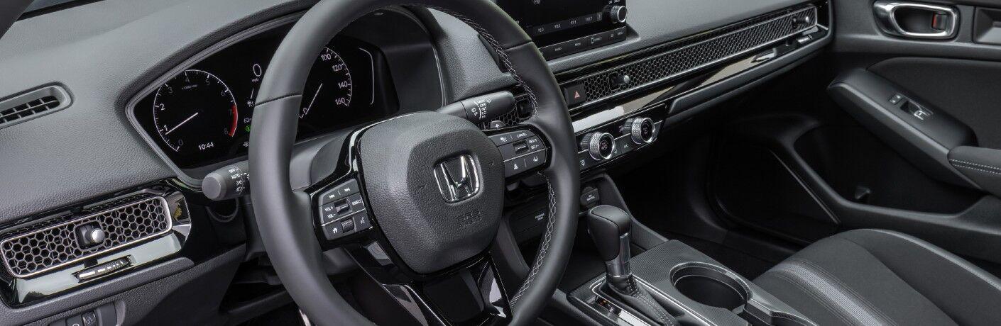 The driver's cockpit in the 2022 Honda Civic Sedan.