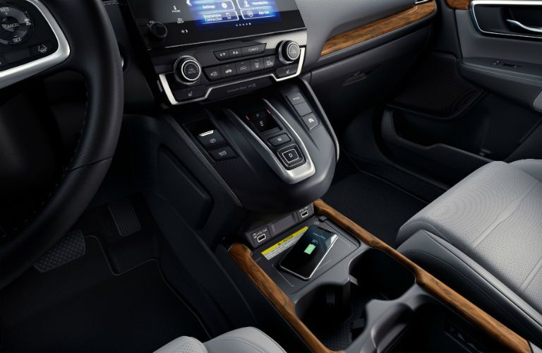 A photo of the lower console in the 2020 Honda CR-V Hybrid.